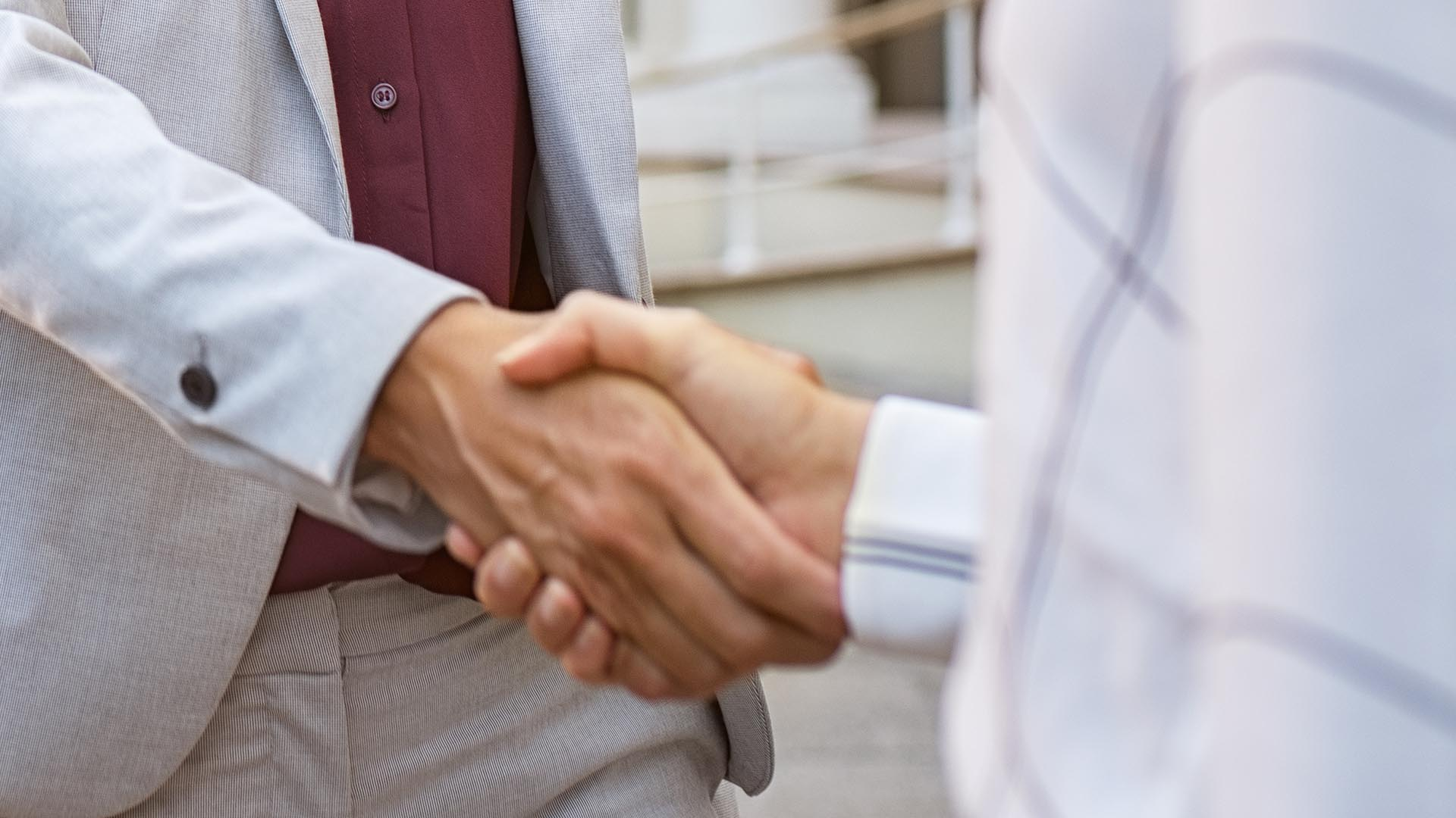concierge medicine | woman shaking hands with someone